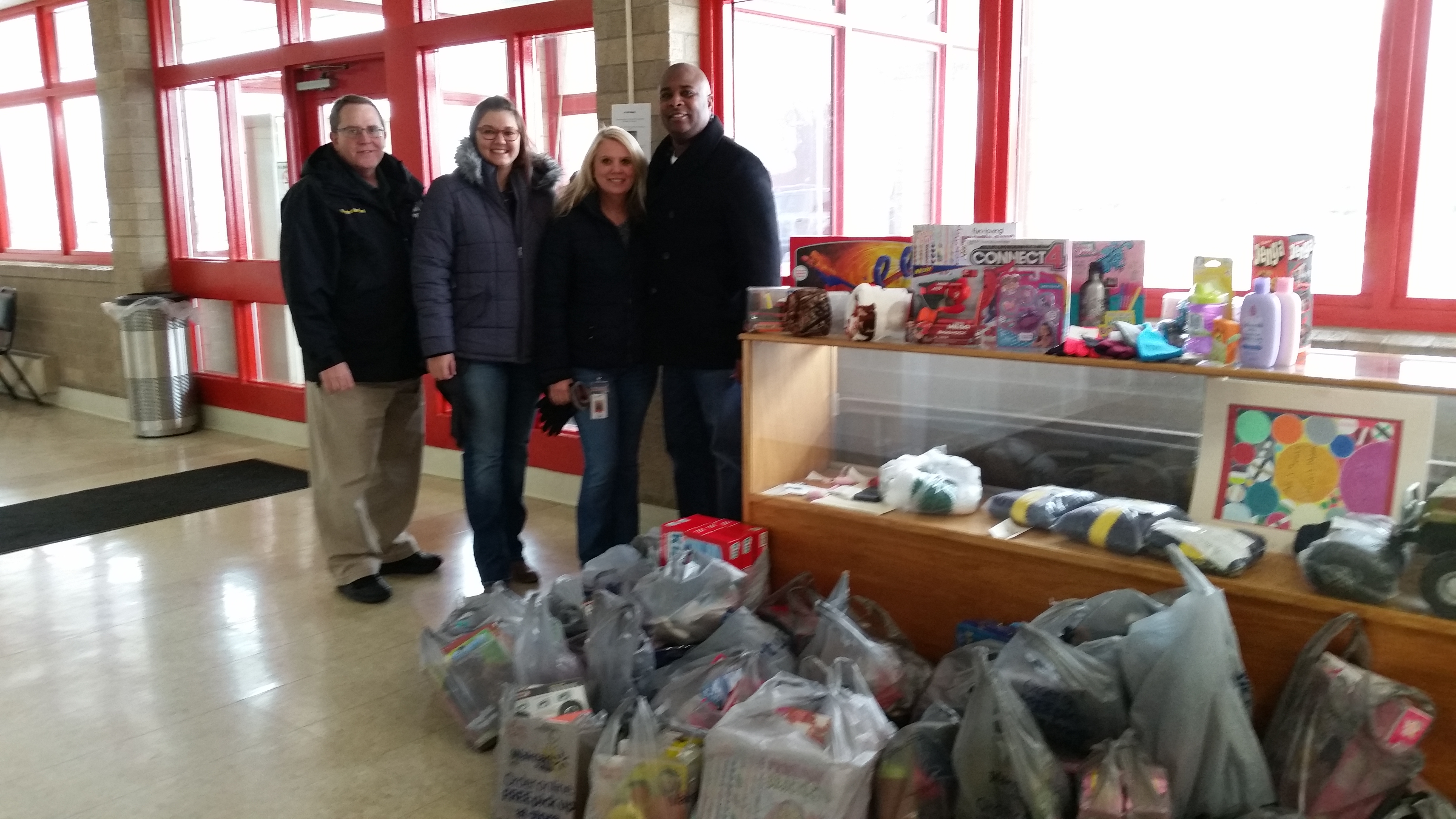 AOCI  Staff Donate Toys to Allen County Children Services