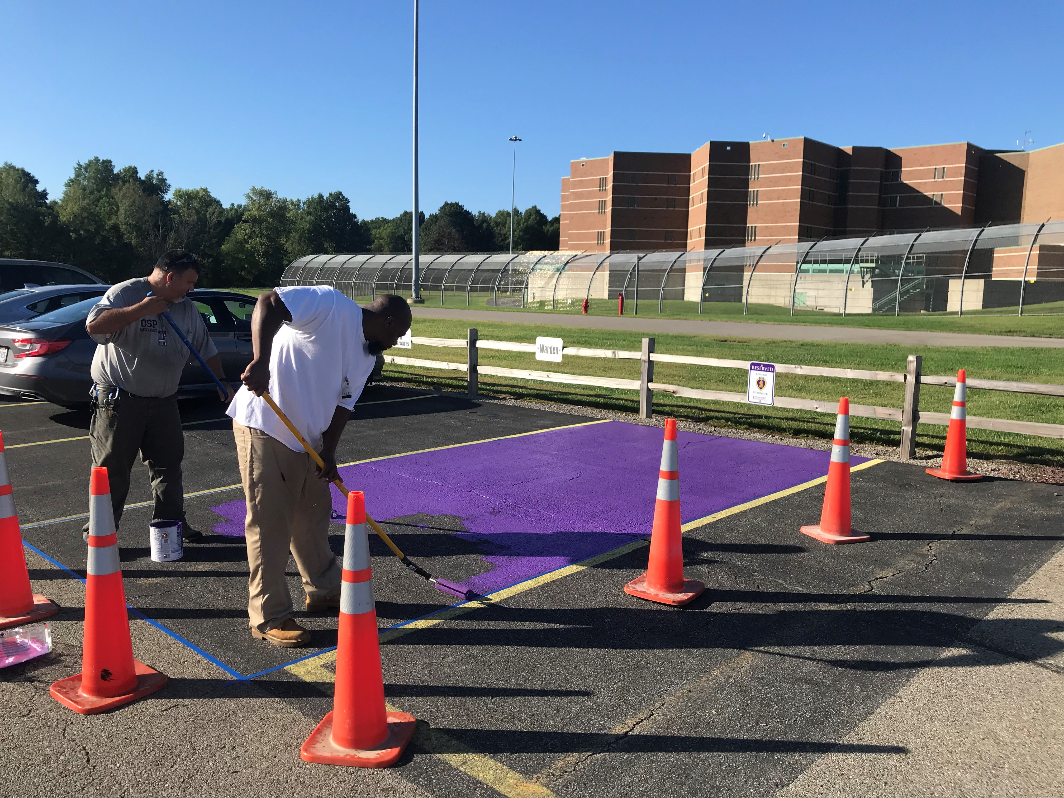 Veterans Committee at OSP Paints Parking Space